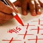 getty_rf_photo_of_man_marking_weightloss_calendar